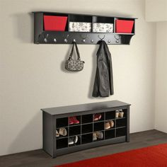 Get the entry way organized with a black hanging shelf and hooks for the most frequently worn items.