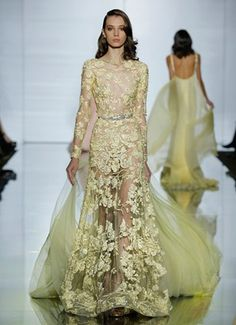 Long sleeved, boat neck dress in silk tulle and yellow guipure lace with crystal and beaded flower embroidery