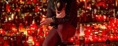 A man touches his forehead holding a candle outside the Colectiv nightclub in Bucharest, Romania. (Vadim Ghirda/AP)