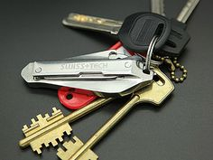 Swiss Tech Micro Slim 9-in-1 key ring tool kit has 3 screwdrivers, 2 knife blades, flat wrench, bottle opener, nail file and is made of stainless steel.