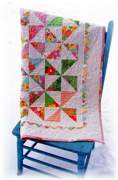 Sweet baby quilt - I like the large pinwheels with the prairie points in the border against the white- WOW must make this in pinks and greens for baby shower in February