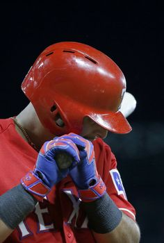 Texas Rangers second baseman Rougned Odor bites his bat after being struck out during the 8th inning against Boston Red Sox at Globe Life Park in Arlington, Texas, Saturday, June 25, 2016. The Texas Rangers won 10-3. (Jae S. Lee/The Dallas Morning News)