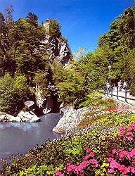 Merano, Italy. The locals' favorite way to enjoy the flowers, the river and the views is to take a stroll along the Merano Promenades. An impressive case of wise urban planning, these are paved sidewalks lined with benches that lead from the heart of the city to the wilderness of its outskirts, in only a few minutes. The Passeggiata Lungo Passirio splits into two paths, the Summer Promenade and the Winter Promenade (which are both available year-round, by the way!).