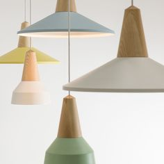 'Eikon' a customizable, interchangeable lighting system by German design firm Schneid. A wooden base (ash, oak, bamboo) with hidden magnets let you swap the Basic lampshade for the Shell or Bubble lampshades.