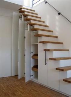 30 Under Stair Shelves and Storage Space Ideas We'll shows you ways to use the space under your stairs as a place for storage. diy closet 10 Under Stair Storage Ideas that Make Your House Look Stunning Stair Shelves, Staircase Storage, Attic Stairs, House Stairs, Staircase Design, Stairs With Storage, Shelves Under Stairs, Space Under Stairs, Stairs To Loft