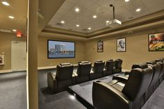 Leather Recliners on risers so everyone has a great view of the 133 inch screen.