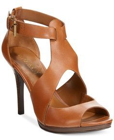 Sexy leather with peep-toe and cutout details make the Beth sandals from Ralph Lauren an easy choice for both day and night looks. | Imported | Leather upper | Almond open-toe sandals with ankle strap