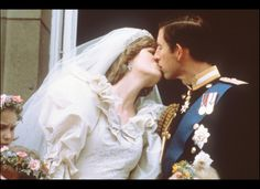 July 29, 1981: The newlyweds Diana and Charles, the Princess and Prince of Wales, kiss on the balcony of Buckingham Palace as the crowds of well-wishers cheered. It was the first time that a royal bride and groom kissed in public and on the balcony of Buckingham Palace. ~ Photo by Getty Images.