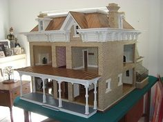 1/12 Scale Replica Historic Doll House - Beautiful This is an interesting way to allow access to rooms in a normal, real floor plan, but to still keep the look of the exterior.