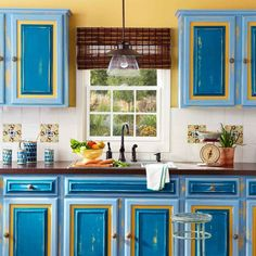 Painted and distressed kitchen cabinet doors- not a huge fan of the yellow, but like the different shades of blue. Distressed Kitchen Cabinets, Farmhouse Kitchen Cabinets, Kitchen Cupboards, New Kitchen, Kitchen Ideas, Kitchen Paint, Kitchen Inspiration, Kitchen Backsplash, Kitchen Stuff