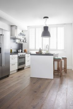 Bring Life To Your Modern Kitchen By Adding This Hardwood Flooring The Oak Planks Are