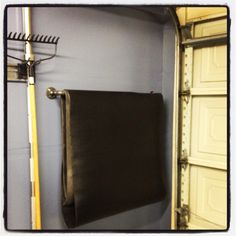 Custom crossfit / yoga mat holder in home garage gym