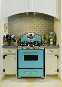 AHHHHHH, I love EVERYTHING about this - the stove, the backsplash, the hood. Source: House of Turquoise: Turquoise Appliances