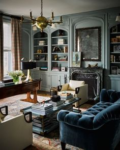 """""""The library was dark and oppressive, and we needed to change that,"""" notes Thomas. """"The original walls and millwork were heavy oak, and I wanted to . Cozy Living Rooms, Home Living Room, Living Room Designs, Living Room Decor, Living Spaces, Small Living, Interior Decorating, Interior Design, Family Room"""