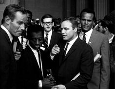 1963 | (from left) Charlton Heston, James Baldwin, Marlon Brando, (rear) Sidney Poitier & Joseph Minklewitz, Harry Belafonte, talk about the Civil Rights Movement of 1963 after attending the Civil Rights March on Washington on August 28, 1963.