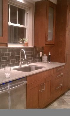 Maple Nutmeg Cabinets With Granite Tops And Light Colored
