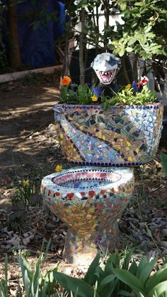 Mosaic Toilets: And you thought you had no use for the stools in our inventory!