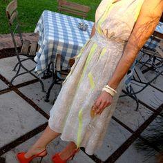 Pairing my mother's #vintage ivory bangles with my #neons & #skinprint dress & bright orange #sergiorossi heels