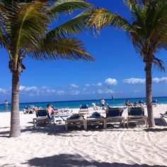 Playa del Carmen - that could have been me in one of those deck chairs.  Or the one getting sick in the ocean.