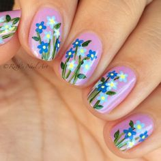 "Forget-me-nots over ""Leslie"" by Zoya. #ruthsnailart #nailart"