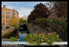 Bridge with flowers over the Kenduskeag stream. Bangor, Maine, USA