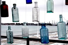 Bottles found in the St. Clair River and now used as an art display at the Great Lakes Maritime Center