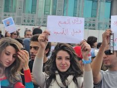 Tunisian Protestor With A Sign That Says Grow The Brain Before The Beard