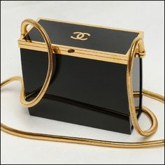 Chanel black and gold Lucite runway vintage box handbag. Chanel black and gold Lucite runway vintage box handbag. Burberry Handbags, Chanel Handbags, Luxury Handbags, Fashion Handbags, Purses And Handbags, Fashion Bags, Designer Handbags, Leather Handbags, Fashion Jewelry