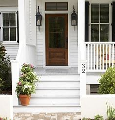 white house, black shutters, wooden steps by lois