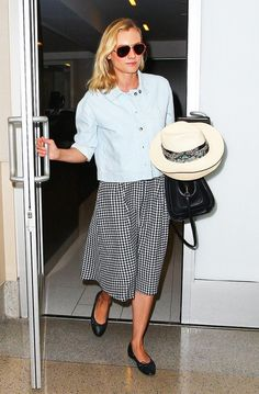 Diane Kruger could easily wear this checkered midi skirt and fedora combo to brunch.