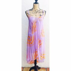 "Cynthia Vincent Purple Embroidered High-Low Dress Twelfth Street by Cynthia Vincent Lilac Purple Silk Dress with Bright Coral/Orange Embroidered with Geometric Sun Shapes. V-Neckline leading into 4 button & loop keyholes. Adjustable thin front straps and Criss-cross thin back straps. Silk Chiffon Sheer fabric with a jersey knit soft slip dress underneath. Hi-low style with a flowing cascade hemline. 42"" long from front hem to shoulder, 50"" back. Perfect for this spring and summer! Size XS…"