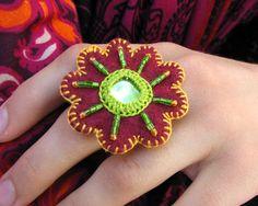 Handmade crochet ring, made of felt, beads and mirror.