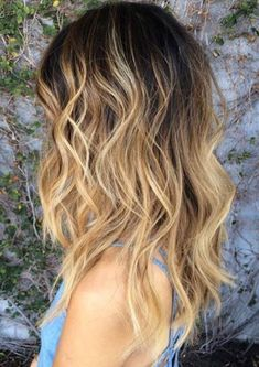 Blonde ends with brown roots mid length hair style