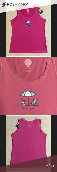"Life Is Good Beach Day Umbrella Chair Tank Top. Selling a Life Is Good Beach Day Umbrella Chair Women's Tank Top.  Size Medium.  Dusty Pink color. New with Tag!  Website Description:  The perfect tee, sans sleeves. Designed to barely skim the body for a flattering silhouette.  Sleeveless Scoop neck. Classic Fit Washed for softness Printed graphic 100% cotton Size Medium Color: Dusty Pink Armpit to armpit: 19.5"" Body length from high point of shoulder:  26"" Life is Good Tops Tank Tops"