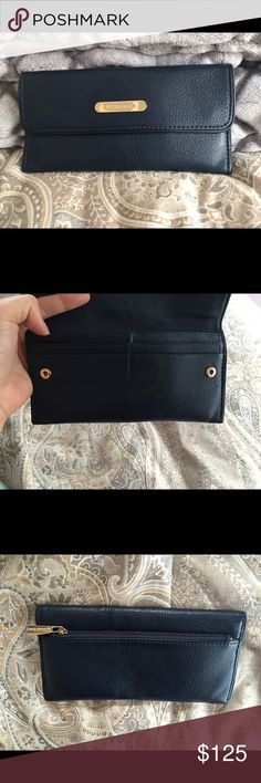 Michael Kors Navy Wallet Michael Kors continental wallet in Navy. Great for those who travel outside of the United States and only want to carry cash and a few credit cards. New without tag wallet. MICHAEL Michael Kors Bags Wallets