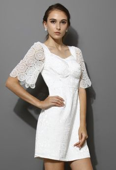 Another pretty dress that I would love to wear but may want to add a little length to lol, I love the crochet sleeve!