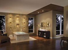 This tub features a water spout from the ceiling. What do you think?