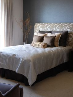 How to Make an upholstered headboard- simpler even, layer of batting under layer of fabric stapled on the back. You can still glue on the trim if you want.