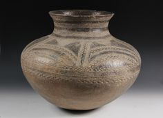AFRICAN POTTERY - Igala People, Nigeria, Large Pot in squat ovoid form, cinched and flared rim, incised geometric decoration, in glazed dark grey clay.