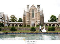 Bride and Groom taking a scenic walk surrounded by beautiful historic brick buildings. Photo by Tessa Marie Photography