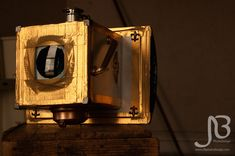 A fascinating 'steampunk camera obscura' created using a flatbed scanner, a magnifying glass, and a whole lot of gold duct tape. http://petapixel.com/2014/09/24/photographer-builds-diy-camera-obscura-with-a-flatbed-scanner-a-magnifying-glass-and-some-gold-duct-tape/