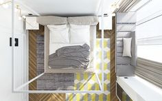 Fun geometric rugs reflect the unique cubic bed frame. Color accents remain tasteful and understated while the gray remains the main emphasis.