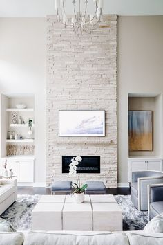 Transitional living room design with stacked stone fireplace and dark hickory floors by Jillian Lare Interior Design - Des Moines, Iowa. Grey Walls Living Room, Paint Colors For Living Room, Paint Colors For Home, Living Room Decor, Light Grey Paint Colors, Light Grey Walls, Dark Colors, White Walls, Light Colors