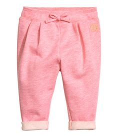 Pink melange. Pants in soft, melange sweatshirt fabric with elastication and a…