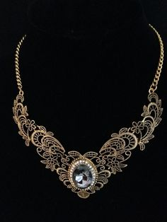 Antique gold filigree necklace with grey acrylic stone $10