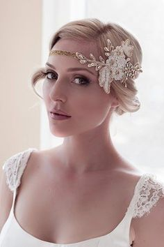 Art Deco bridal style: Short hairstyle, cap sleeved scoopneck wedding dress and glam gold and white bridal headband with no veil.