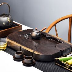 The tea tray, also known as the Chachuan (tea ship) and Chaxi (tea wash), it is a essencial item for gongfu tea and gongfu tea ceremony. This gongfu tea tray is used for brewing tea in the traditional Chinese Gong Fu style. Asian Living Rooms, Tea Tables, Japanese Tea House, Magic House, Tea Culture, Serving Tray Wood, Tea Tray, Cuppa Tea, Brewing Tea