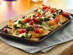 Greek hummus nachos! here's a great snack that couldn't be simpler, make these tasty Mediterranean nachos in 20 minutes.