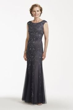 Vintage glamour at its best, this enchanting cap sleeve beaded gown is a true masterpiece!  Cap sleeve gown features all over intricate beaded detail.  Eye-catching scoop back adds a touch of drama and even more allure.  Fully lined. Back zip. Imported polyester. Spot clean.