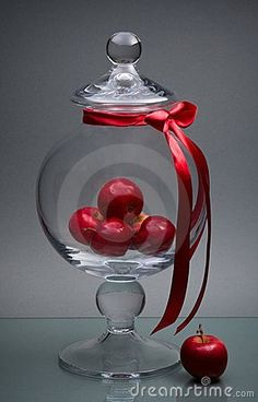Glass vase with cover and apples on gray Photo by Viktor Prokopenya on Dreamstime